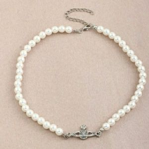 VW bas relief chocker style pearl necklace